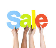 Multi Ethnic People Holding The Word Sale Royalty Free Stock Photography