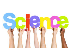 Multi Ethnic People Holding The Word Science Royalty Free Stock Photo