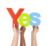 Multi Ethnic People Holding The Word Yes Royalty Free Stock Photography