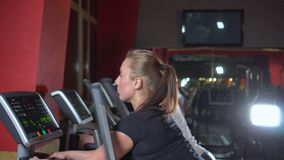 Multi ethnic people keeping fit exercising on modern gym equipment. Sports beautiful women in the gym. The trainer play. Sports. The woman trains stock video