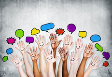 Multi Ethnic People's Hands Raised with Speech Bubble royalty free stock image