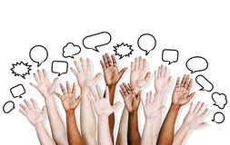 Multi Ethnic People's Hands Raised with Speech Bubble Royalty Free Stock Photography