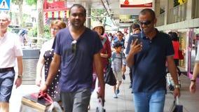 Multi ethnic people walking on Orchard Road. Singapore - January 08, 2018: crowded multi ethnic people people walking on Orchard Road Singapore stock video