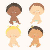 Multi-ethnic set of four babies sitting. Toddler girls and boys. Royalty Free Stock Photo