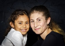 Multi-ethnic sisters studio portrait Stock Photography