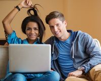 Multi ethnic students couple preparing for exams Royalty Free Stock Image