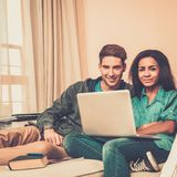 Multi ethnic students couple preparing for exams Royalty Free Stock Photos