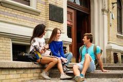 Multi ethnic students near university building Royalty Free Stock Photo