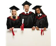 Multi ethnic  students with notice board Stock Photo