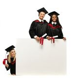 Multi ethnic  students with notice board Royalty Free Stock Image