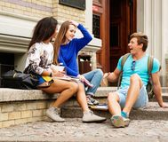 Multi ethnic students outdoors Royalty Free Stock Image