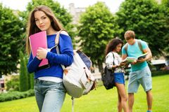 Multi ethnic students in park Stock Image