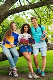 Multi ethnic students in park royalty free stock photography
