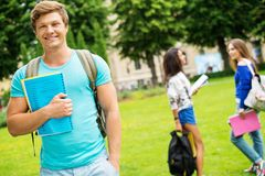 Multi ethnic students in park Royalty Free Stock Images