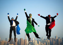 Multi-Ethnic Superhero Businessmen Jumping Stock Image