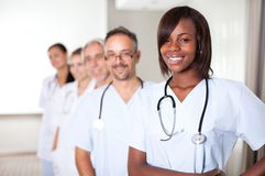 Multi-ethnic team of confident happy doctors Stock Photos
