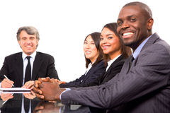 Multi-ethnic team during a meeting. In white background Stock Images