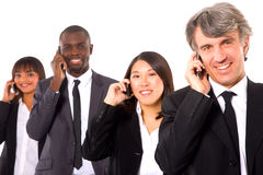 Multi-ethnic team with mobile Stock Photos