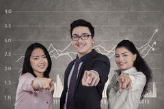 Multi ethnic team pointing at camera Stock Photo