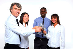 Multi-ethnic team toasting Stock Image