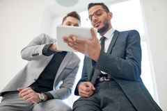 Multi-Ethnic Team Wrapped up in Work stock photos