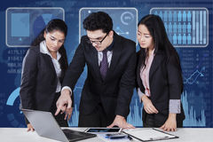Multi ethnic teamwork in business meeting Stock Photography