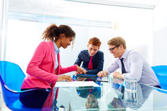 Multi ethnic teamwork of young business people Stock Images