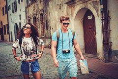 Multi ethnic tourists couple with map in old city Royalty Free Stock Images