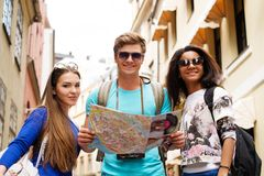 Multi ethnic tourists in old city Stock Images