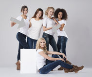 Multi ethnic women. Showing on white board stock photography