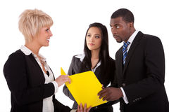 Multi ethnic work colleagues. In a meeting Stock Photography