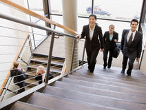 Multi-ethnic workers ascending office stairs