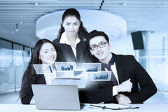 Multi ethnic workers with chart in office Royalty Free Stock Image