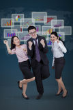 Multi ethnic workers expressing their achievement Stock Photos