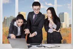 Multi ethnic workers meeting in office Stock Photo