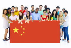 Multi-Ethnic Young People With Flag of China.  royalty free stock photography