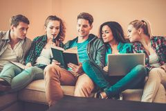 Multi ethnic young students preparing for exams Royalty Free Stock Images