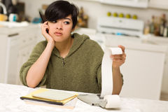 Multi-ethnic Young Woman Agonizing Over Financials Royalty Free Stock Photo