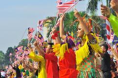 Multi ethnics Malaysia with the national flags. 16th September 2011 , Kuala Lumpur, Malaysia : Multi ethnics races in Malaysia perform dances during the Malaysia Royalty Free Stock Photography