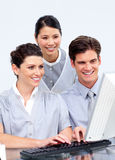 Multi-etnic business people working at a computer Royalty Free Stock Photography