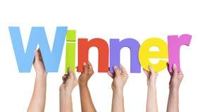 Multi-etnische Groep de Winnaar van de Handenholding Stock Foto's