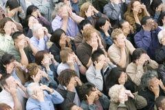 Multi Etnische Mensen die Hun Ogen behandelen Stock Foto