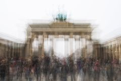 Multi exposure of Brandenburg Gate with tourist crowd in Berlin Germany Stock Image