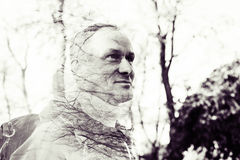 Multi exposure portrait of a happy man with trees branches Royalty Free Stock Images