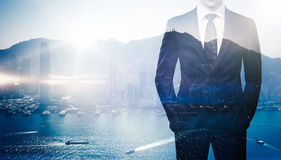 Multi exposure of young business man in the modern Stock Photo