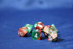 Colored Multi-Faced Dice. Dice used for role playing games on blue Royalty Free Stock Images