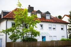 Multi-family house with red facade Stock Photos