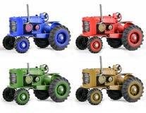 Multi Farbe Toy Tractors auf Weiß Stockfotografie
