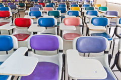 Multi farbige Stühle stockbilder