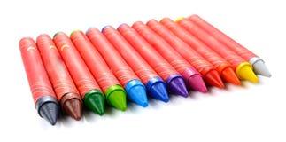 Multi farbiges vax-Bleistiftisolat auf weißem Hintergrund Stockbilder